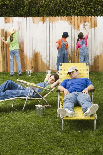 Stock Photo: 1589R-41673 Mixed Race family painting fence