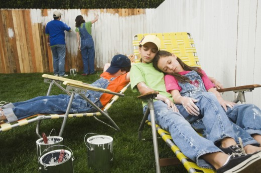 Stock Photo: 1589R-41674 Mixed Race family painting fence