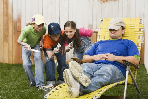 Stock Photo: 1589R-41675 Mixed Race family painting fence