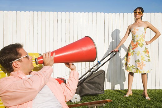 Stock Photo: 1589R-41688 Man yelling at wife pushing lawn mower