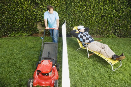 Stock Photo: 1589R-41705 Man mowing lawn while neighbor sleeps