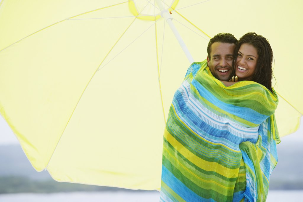 South American couple at beach : Stock Photo