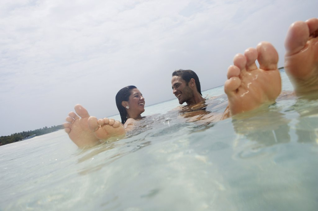 South American couple in water : Stock Photo