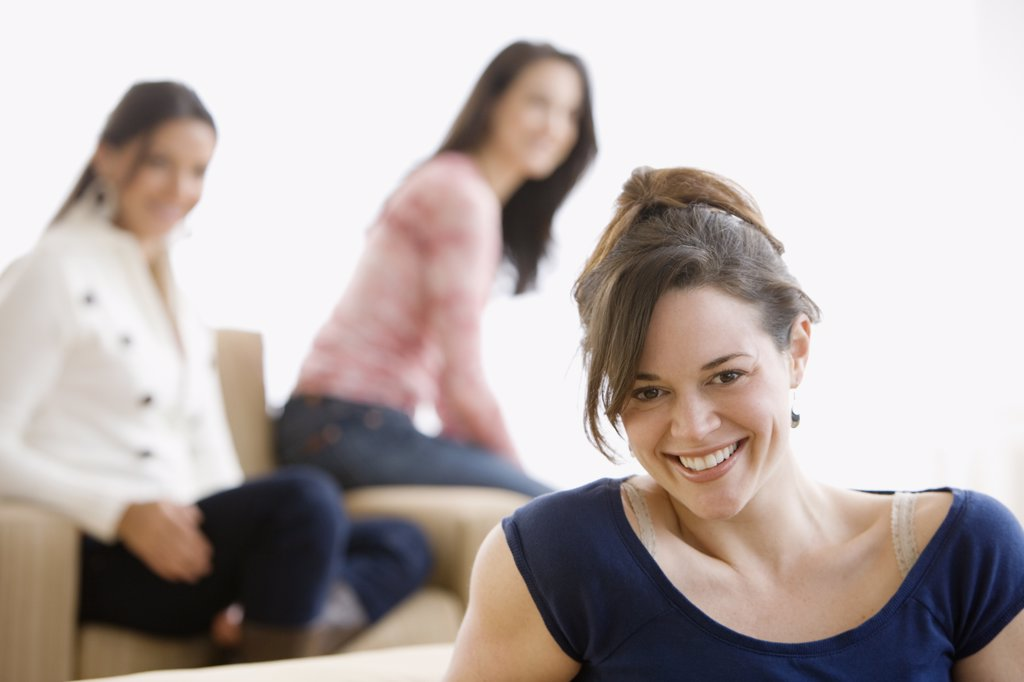 Stock Photo: 1589R-42129 Hispanic woman with friends in background