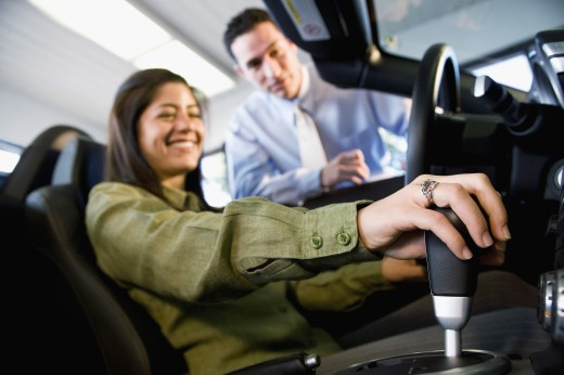 Stock Photo: 1589R-42187 Woman sitting in new car