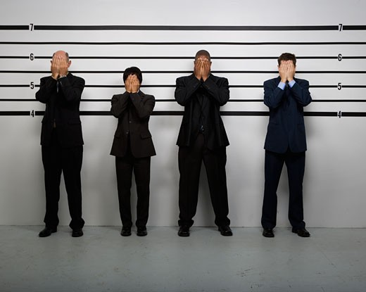 Stock Photo: 1589R-42207 Multi-ethnic businessmen covering faces in police line up