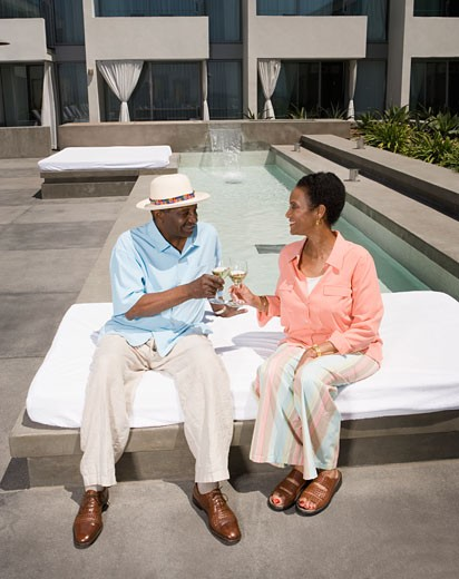 Stock Photo: 1589R-42276 Senior African couple toasting with wine