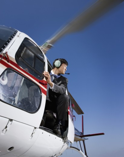 Asian businessman in helicopter : Stock Photo