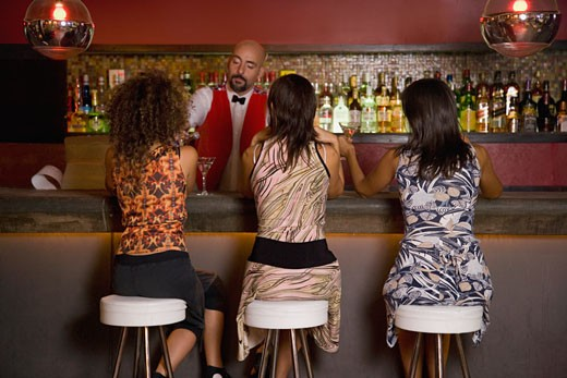 Stock Photo: 1589R-42447 Hispanic women sitting at bar