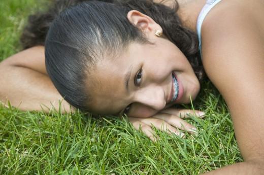Stock Photo: 1589R-42517 Hispanic girl laying in grass