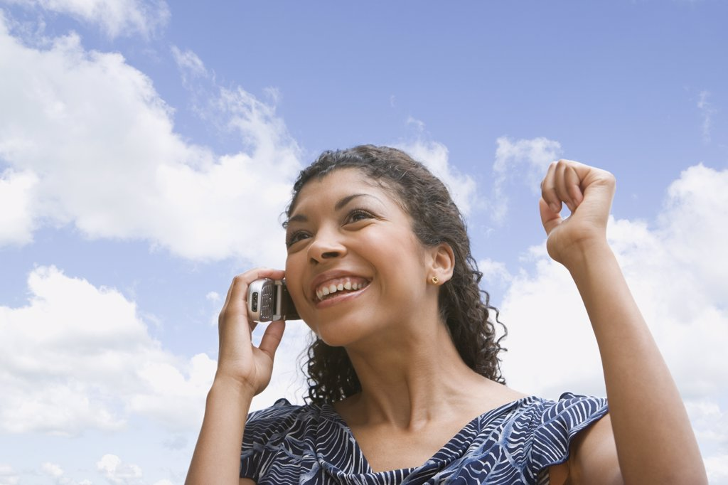 African American woman talking on cell phone : Stock Photo