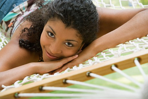 African American woman laying in hammock : Stock Photo