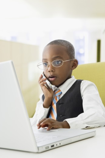Stock Photo: 1589R-42751 African American boy pretending to be businessman
