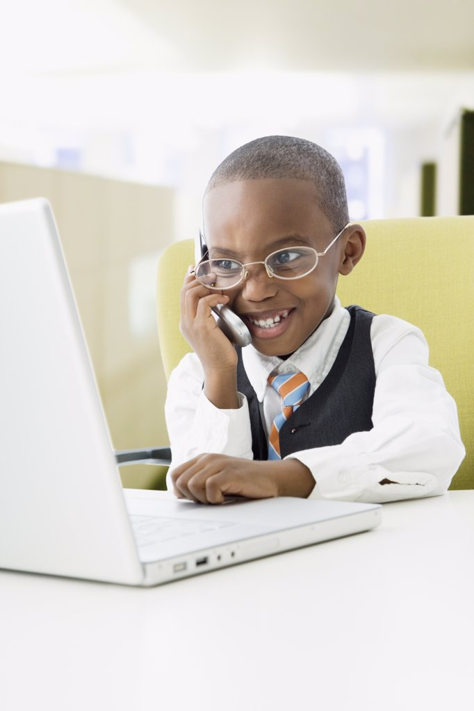 African American boy pretending to be businessman : Stock Photo