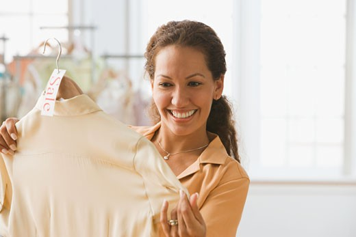 Hispanic woman shopping for clothing : Stock Photo