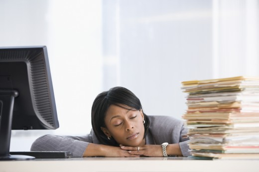 Stock Photo: 1589R-42826 African American businesswoman sleeping at desk