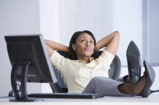 Stock Photo: 1589R-42833 African American businesswoman with feet on desk