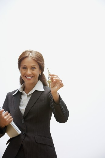 Hispanic businesswoman holding keys : Stock Photo