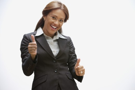 Hispanic businesswoman giving thumbs up : Stock Photo