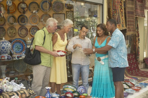 Stock Photo: 1589R-43107 Senior couple shopping for pottery