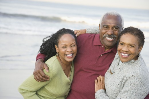 Stock Photo: 1589R-43157 African family hugging at beach