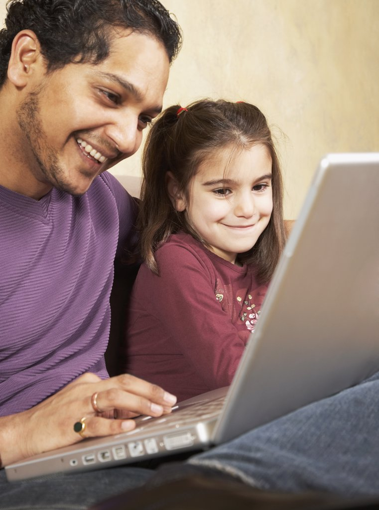 Stock Photo: 1589R-43348 Indian father and daughter looking at laptop