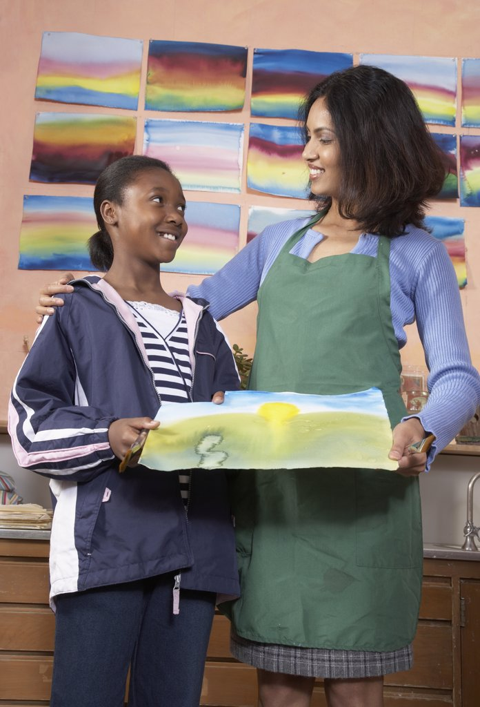 Stock Photo: 1589R-43417 Indian female art teacher and student