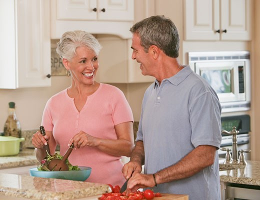 Stock Photo: 1589R-43554 Senior Hispanic couple preparing food