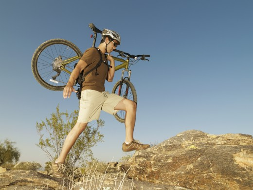 Stock Photo: 1589R-43705 Hispanic man carrying bicycle
