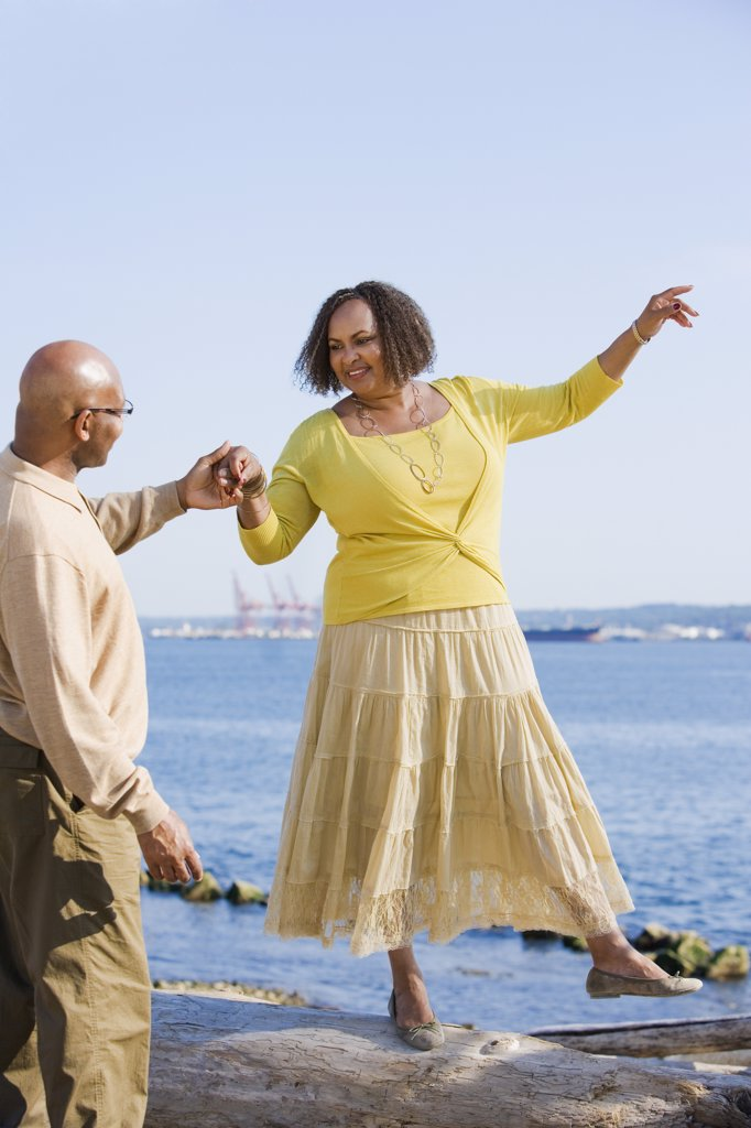 African American woman holding husband's hand for balance : Stock Photo