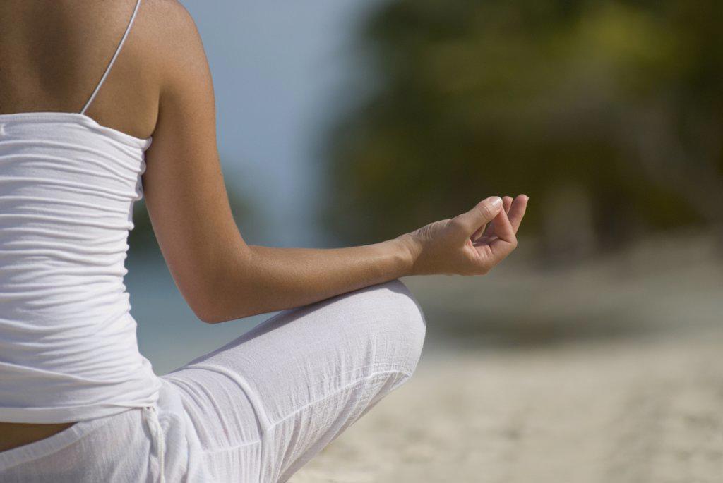 Hispanic woman meditating : Stock Photo