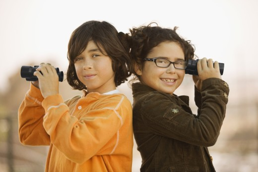 Stock Photo: 1589R-44331 Hispanic brother and sister holding binoculars