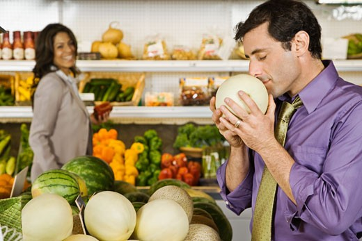 Stock Photo: 1589R-44336 Hispanic couple shopping in grocery store