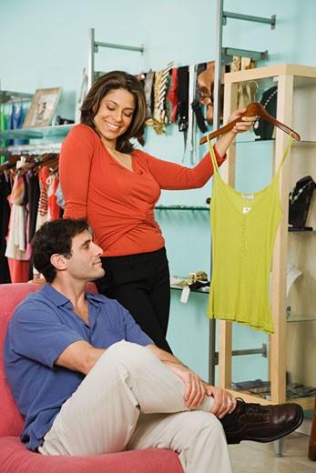 Hispanic couple shopping in clothing store : Stock Photo