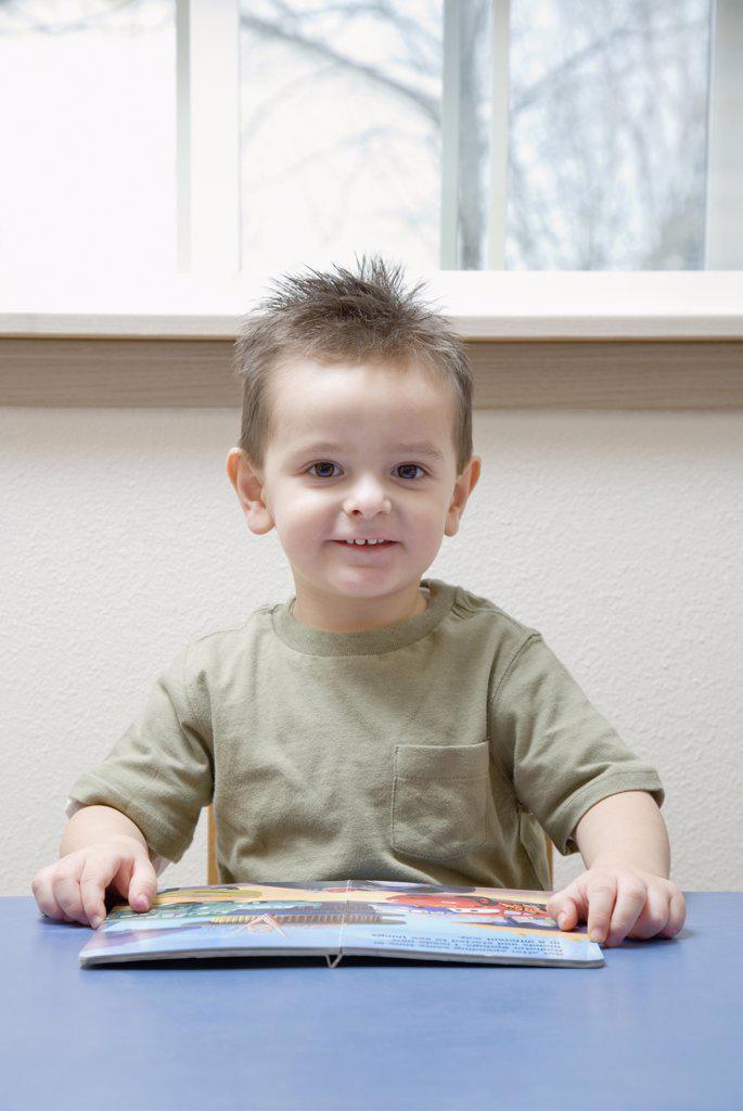 Stock Photo: 1589R-44488 Hispanic boy reading book