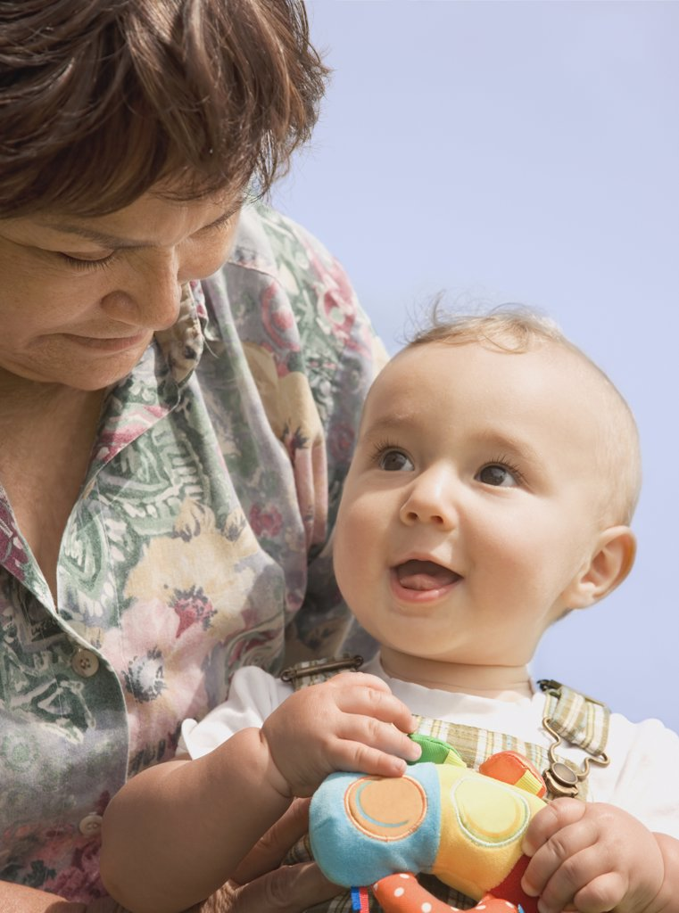 Stock Photo: 1589R-44616 Hispanic grandmother holding baby