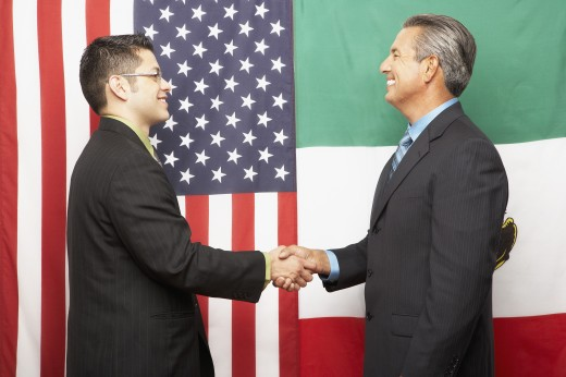 Hispanic businessmen shaking hands : Stock Photo