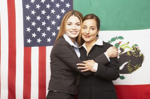 Stock Photo: 1589R-44826 Hispanic businesswomen hugging