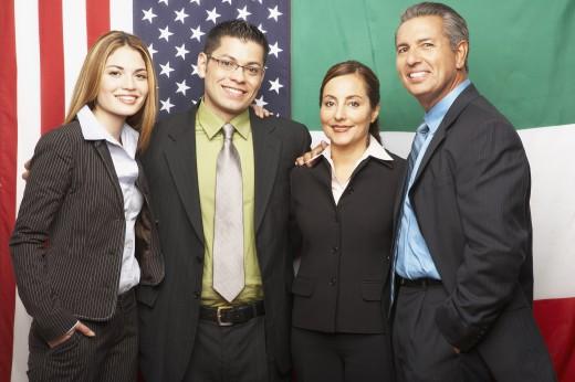 Group of Hispanic businesspeople hugging : Stock Photo