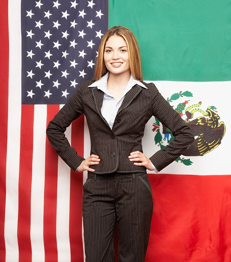 Stock Photo: 1589R-44829 Hispanic businesswoman in front of American and Mexican flags