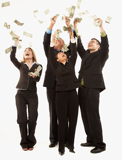 Stock Photo: 1589R-44837 Money raining down on Hispanic businesspeople
