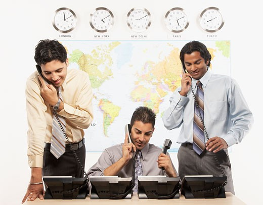 Indian businessmen talking on telephones : Stock Photo