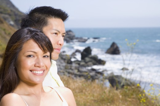 Stock Photo: 1589R-44997 Asian couple at beach