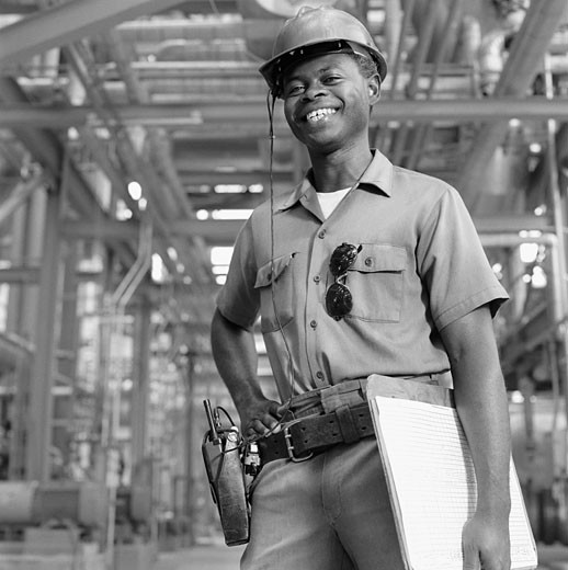 Stock Photo: 1589R-45011 African American male welder with clipboard