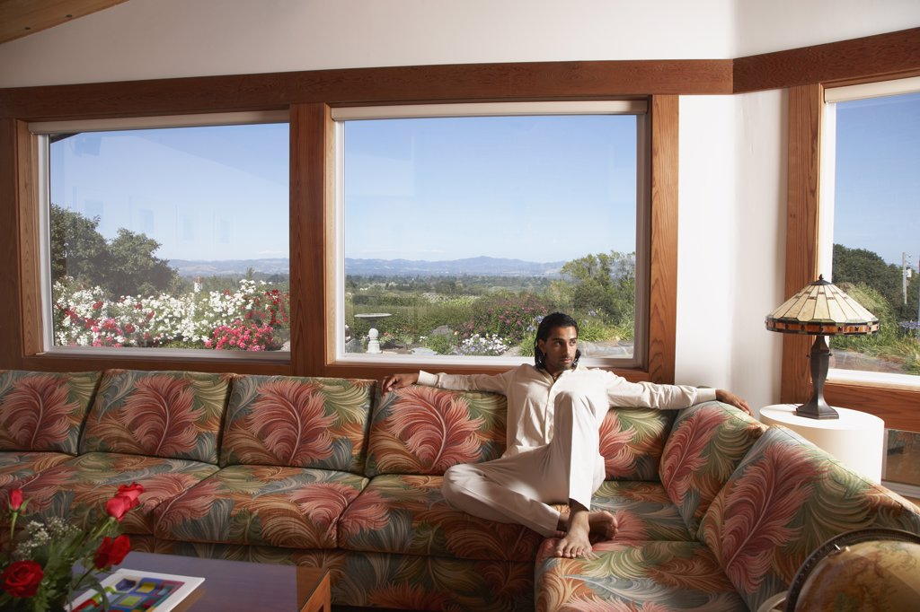 Stock Photo: 1589R-45149 Indian man sitting on sofa