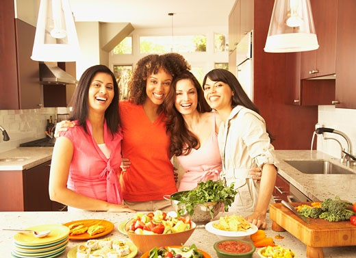 Multi-ethnic female friends hugging : Stock Photo