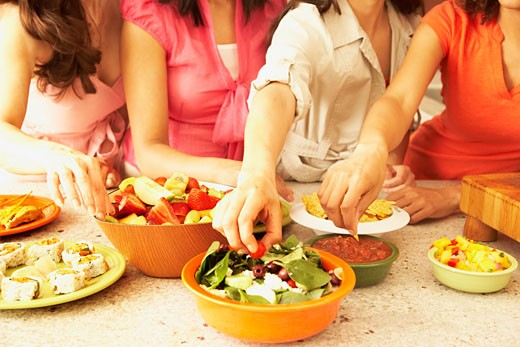 Stock Photo: 1589R-45334 Multi-ethnic female friends eating