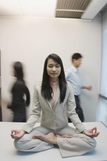 Stock Photo: 1589R-45757 Asian businesswoman meditating