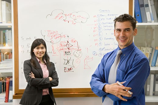 Stock Photo: 1589R-45848 Multi-ethnic businesspeople in front of whiteboard