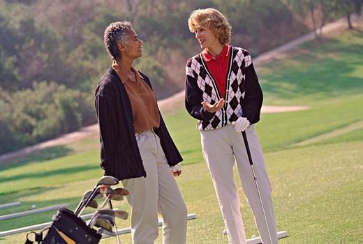 Multi-ethnic senior women on golf course : Stock Photo